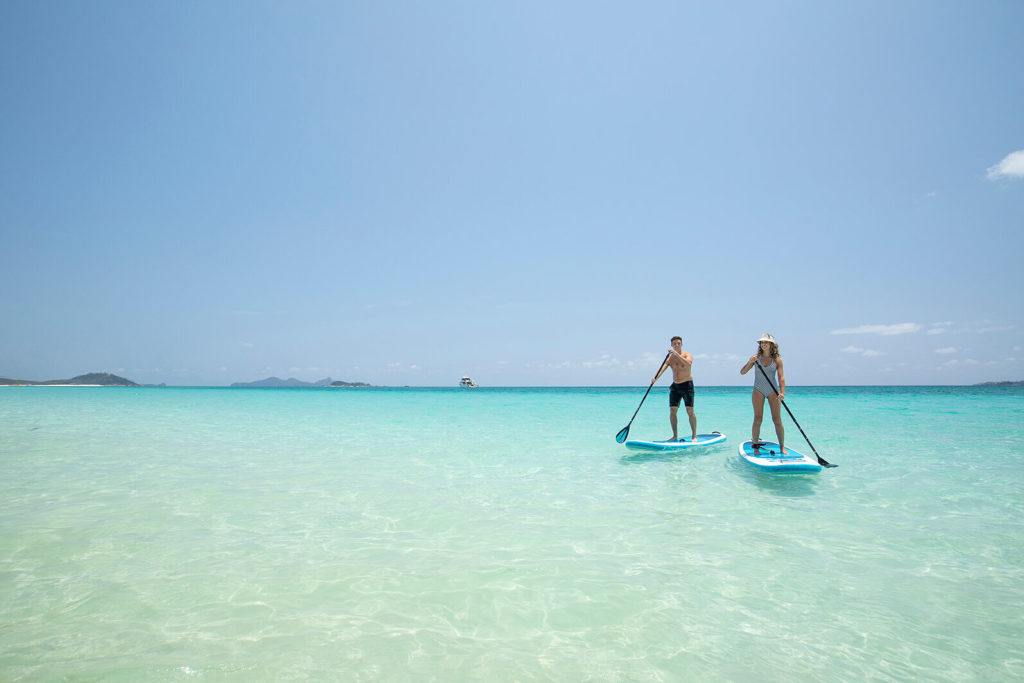 stand up paddleboard couple escape holiday